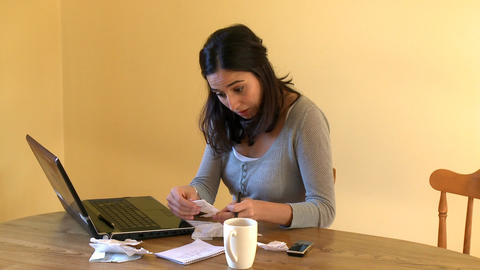 Unhappy woman doing her accounts Stock Video Footage