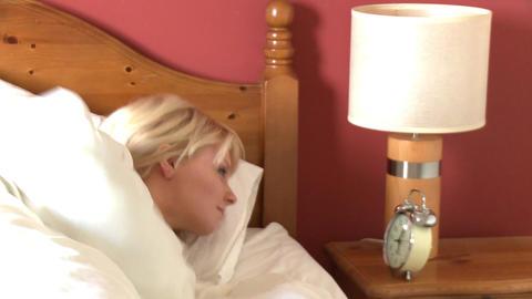 Asleep woman waking up Footage