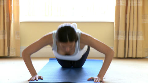 Athletic woman doing pushups Stock Video Footage