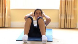 Positive woman doing situps Footage