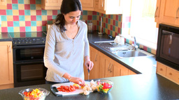 Smiling woman preparing salad Footage