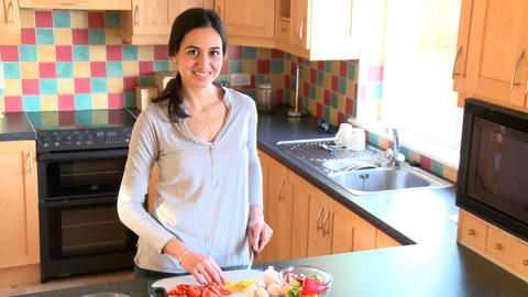Smiling woman preparing salad Stock Video Footage