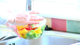 Close up of a woman rinsing vegetables Footage
