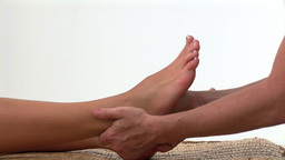 Portrait of a woman enjoying a foot massage Stock Video Footage