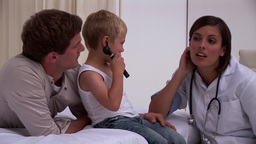 Blond little boy and his father playing with a doc Footage