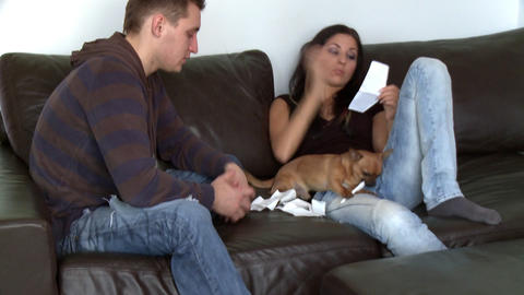 Bitter couple doing their accounts sitting on sofa Footage