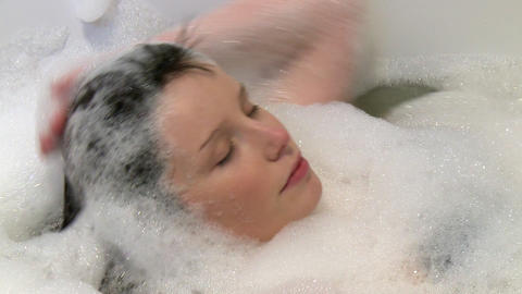 Relaxed woman having a bath Stock Video Footage