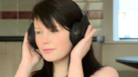 Close up of a charming woman listening music Live Action