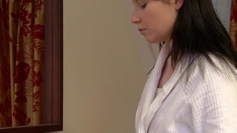 Caucasian woman putting skin powder Footage