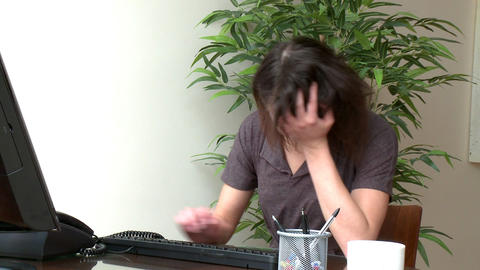 Stressed woman working at a computer Footage