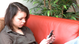 Brunette woman sending a text message Footage