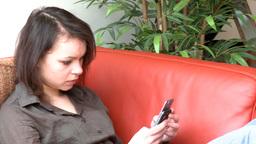 Brunette woman sending a text message Footage