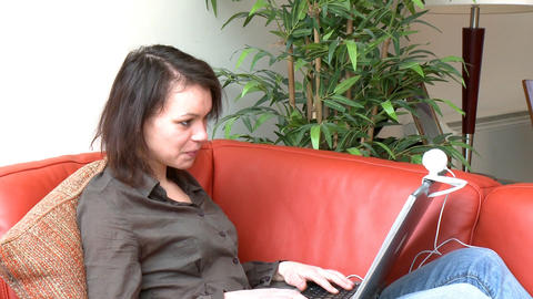 Positive woman communicating by web cam Stock Video Footage