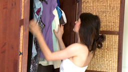 Attractive young woman choosing clothes Stock Video Footage