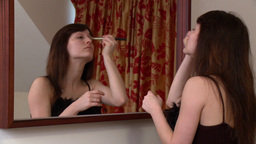 Attractive woman putting mascara Stock Video Footage