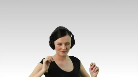 Woman dancing to music on headphones Footage