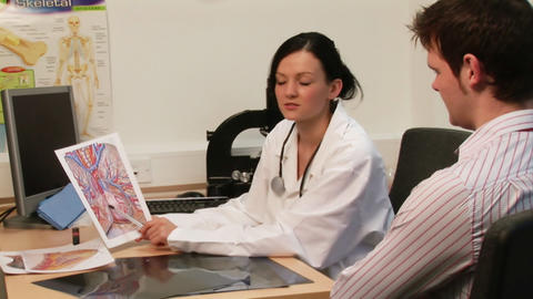 Doctor talking to a patient Footage