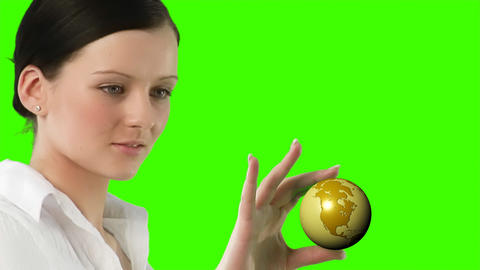 Green Screen Footage of a woman holding a Globe Footage