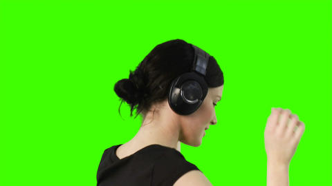 Green screen of a woman listening to music Stock Video Footage