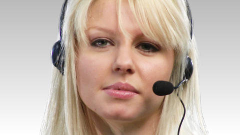Woman on headset being positive Footage