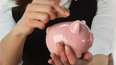 Saving Money in a Piggy Bank Stock Video Footage