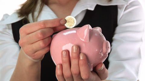 Woman Saving Money in a Piggy Bank Footage