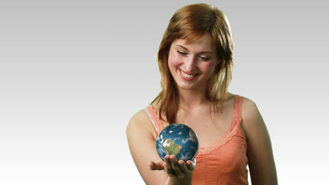 Attractive lady holding the earth Footage