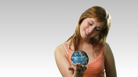 Attractive lady holding the earth Stock Video Footage
