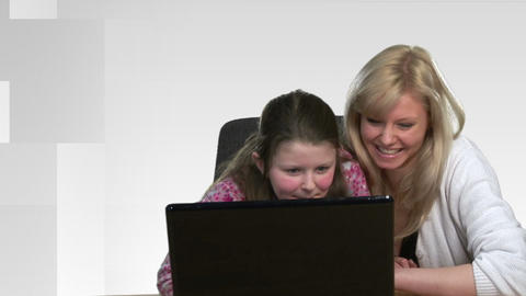 Mother helping Child on Computer Footage