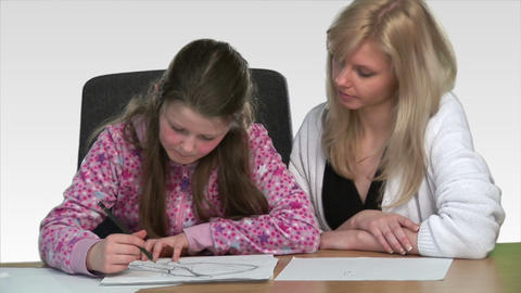 Mother heling her child with homework Stock Video Footage