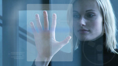 Businesswoman touching a security system Footage