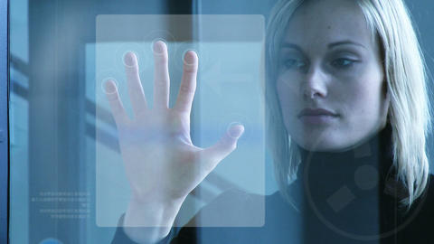 Businesswoman touching a security system Stock Video Footage