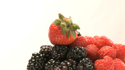 Rotary cluster of blackberries and strawberries Footage