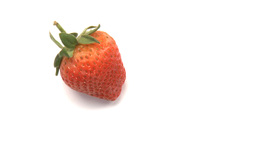 one strawberry Stock Video Footage