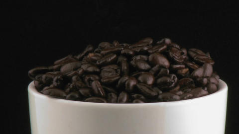 Cup with coffee beans Stock Video Footage