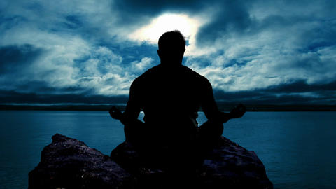 Man meditating at Sunset Stock Video Footage