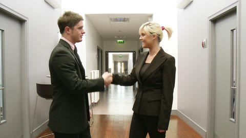 Business handshake in a corridor Footage