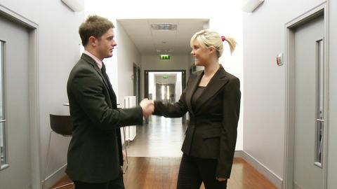 Business handshake in a corridor Footage