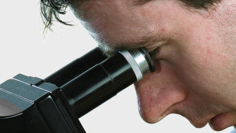 Man looking into a microscope Footage