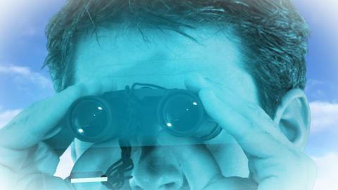 Businesssman looking into Binoculars Stock Video Footage