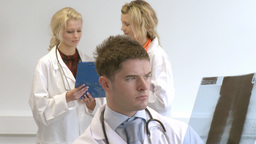 Three doctors working as a team Stock Video Footage