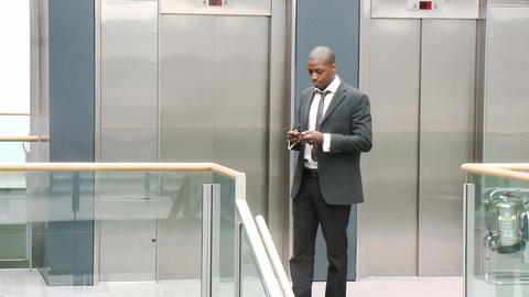 AfroAmerican businessman on phone in a building Stock Video Footage