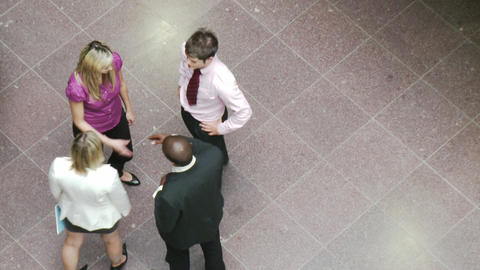 High angle of business people shaking hands in building Animation