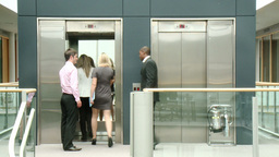 Business people using a lift in building Animation