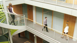 Business people walking through different floors o Footage