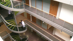 High angle of doctors going upstairs in a hospital Footage