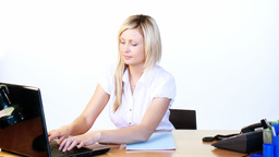 Thoughtful businesswoman working in office Stock Video Footage
