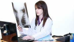 Brunette doctor examining an xray in hospital Stock Video Footage