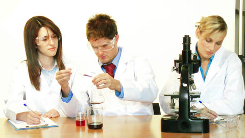 Scientists working in a laboratory and supervisor Stock Video Footage