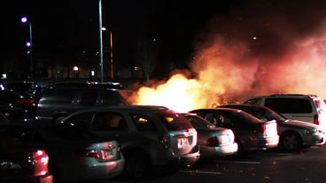 1612 Big Car Fire In Parking Lot With Fire Trucks stock footage